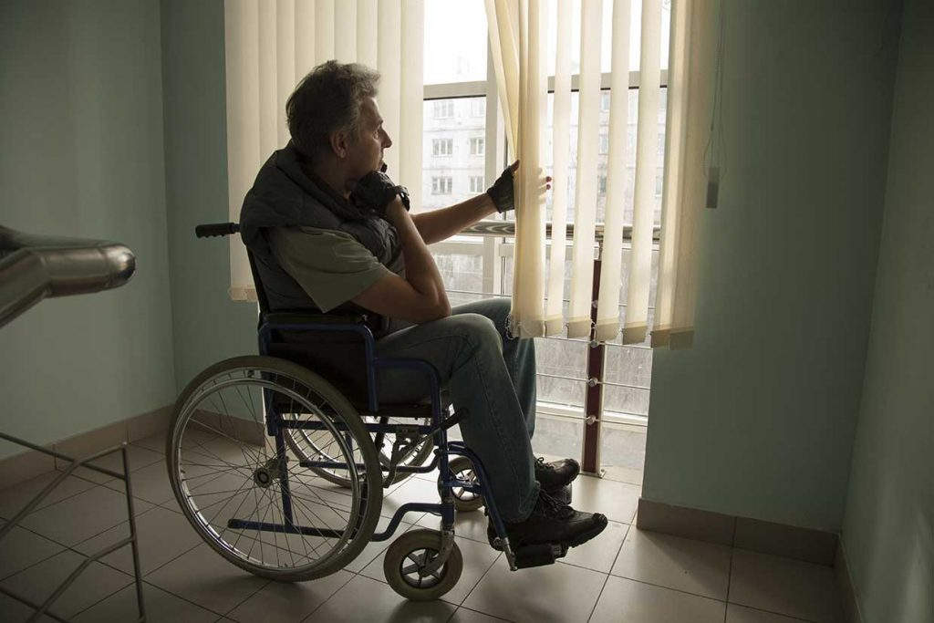 man in wheelchair of nursing home